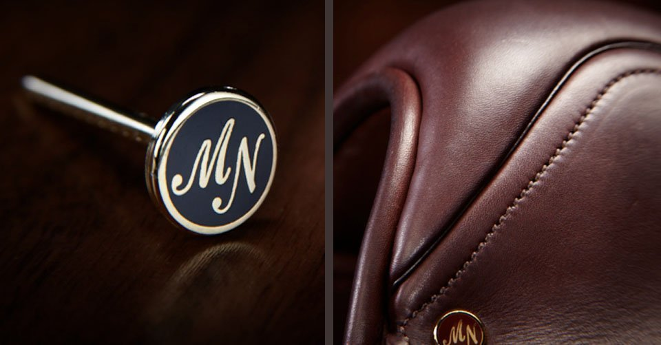 saddle and logo pin