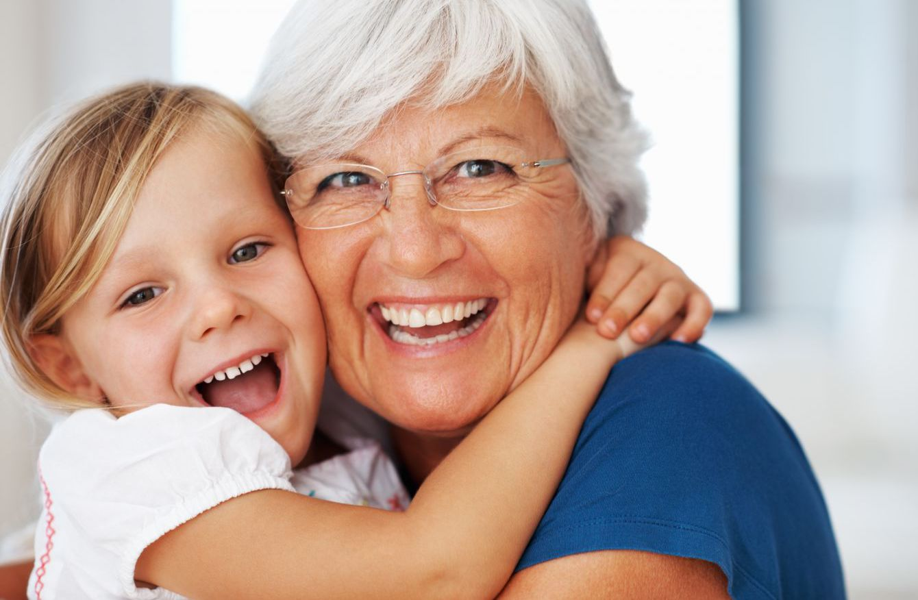 Child and grandparent happy with family dentist in Honolulu, HI