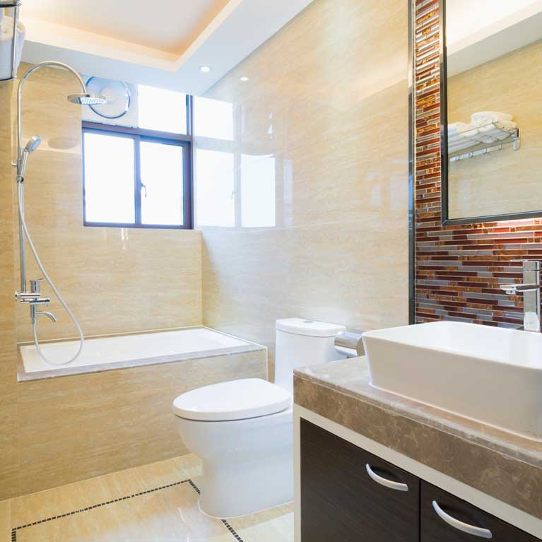 Modern ensuite with vanity, shower, bath and toilet