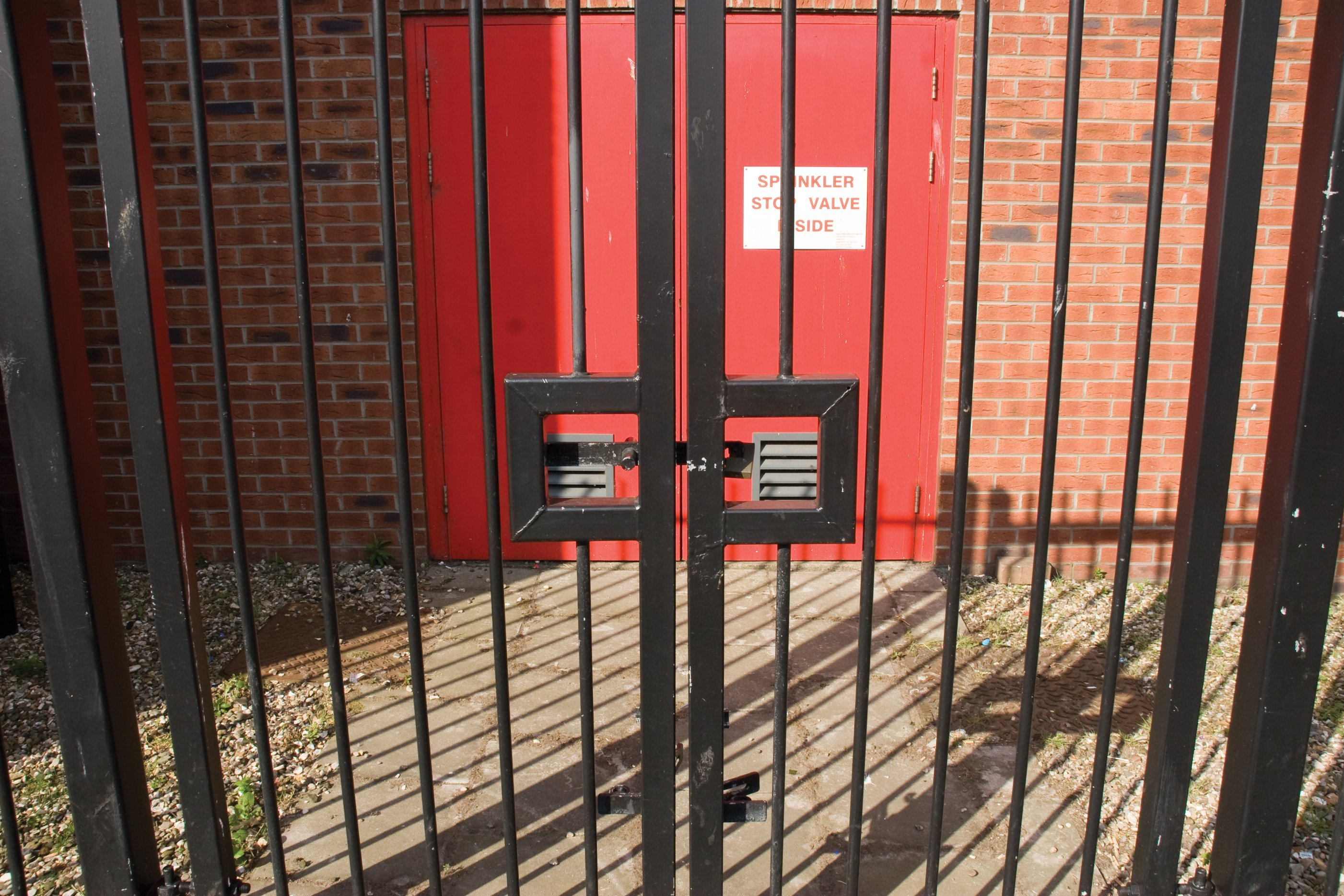 Closed wrought iron gates to a commercial premises