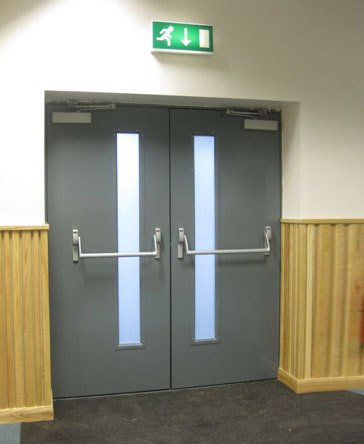 A closed grey emergency exit