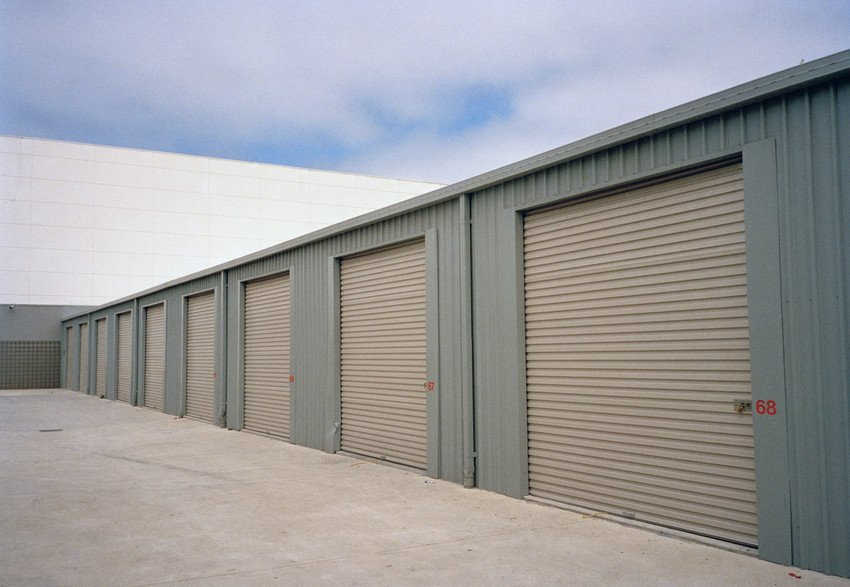 A row of garages with roller garage doors