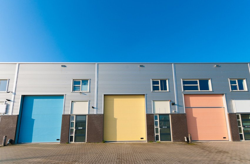 3 industrial garages with different coloured doors