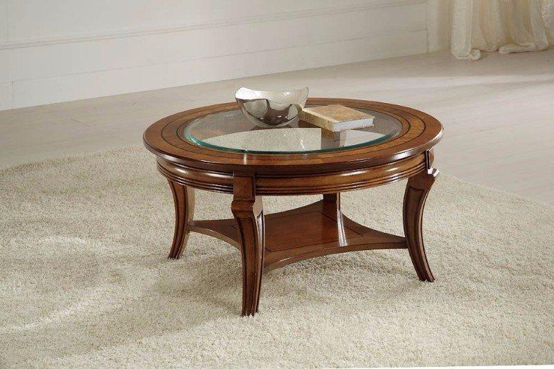 un tavolino in legno con superficie di cristallo