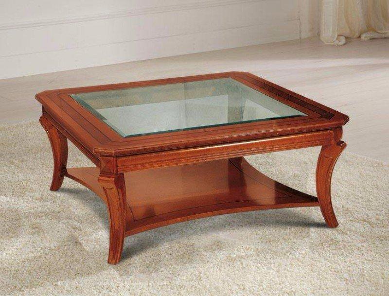 un tavolino rettangolare in legno con una superficie di cristallo