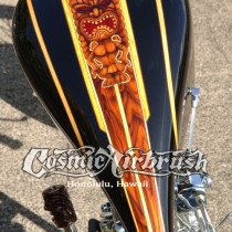 This award winning chopper with hand carved koa handgrips and items along with a cool tiki themed paint job by Dennis Mathewson
