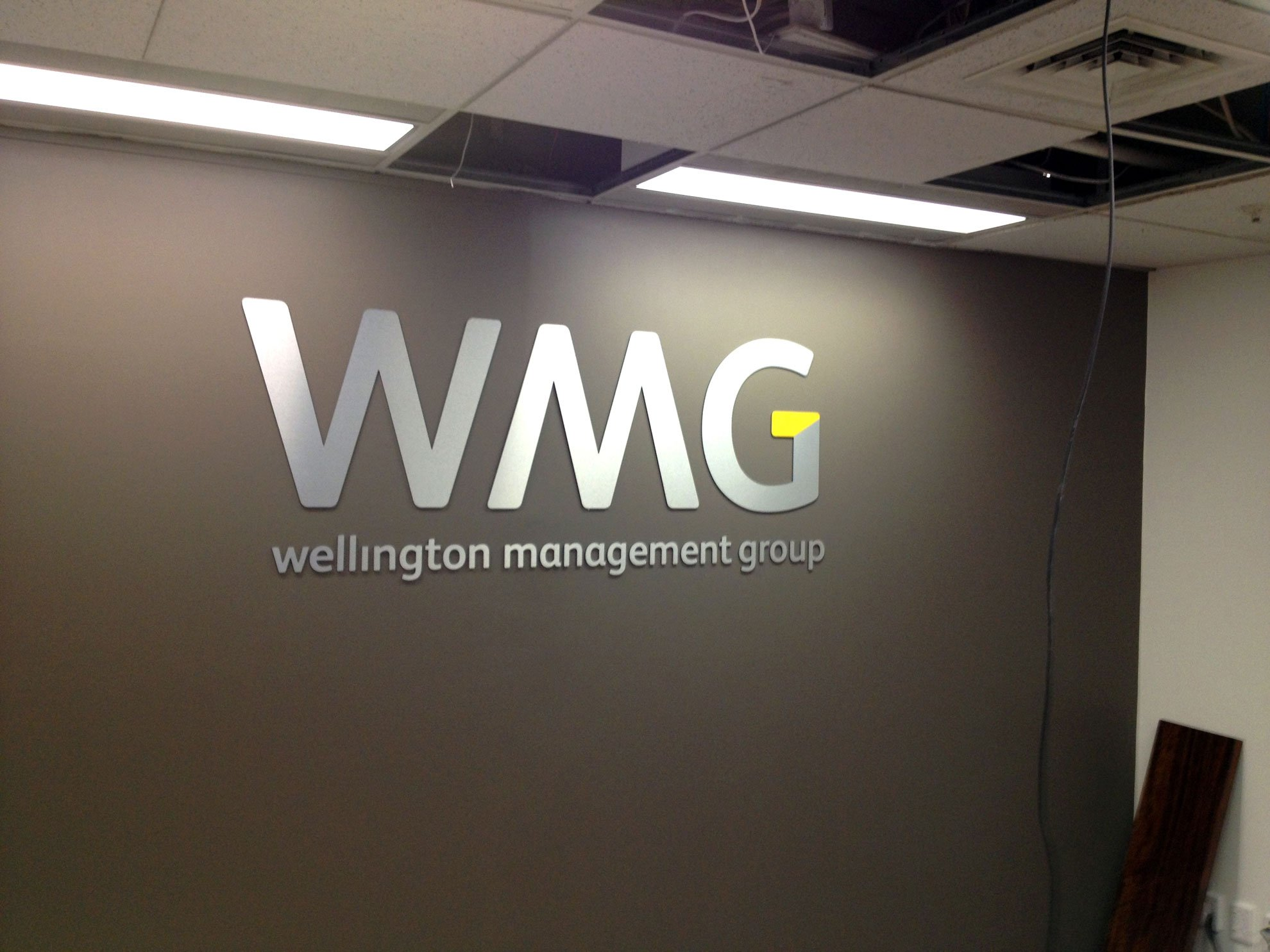 4mm thick laser cut brushed silver ACM letters installed onto office reception wall