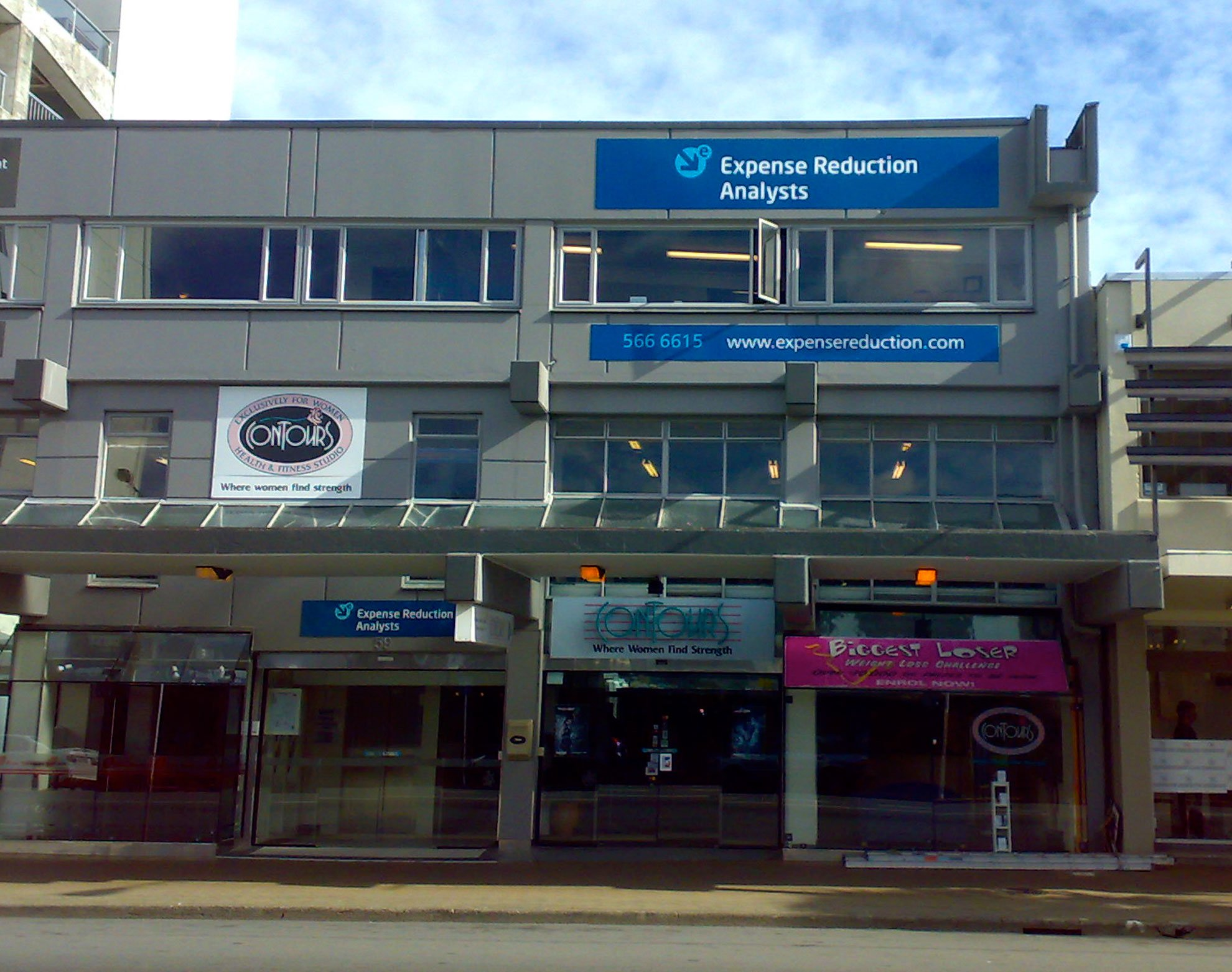 ACM signs installed onto building