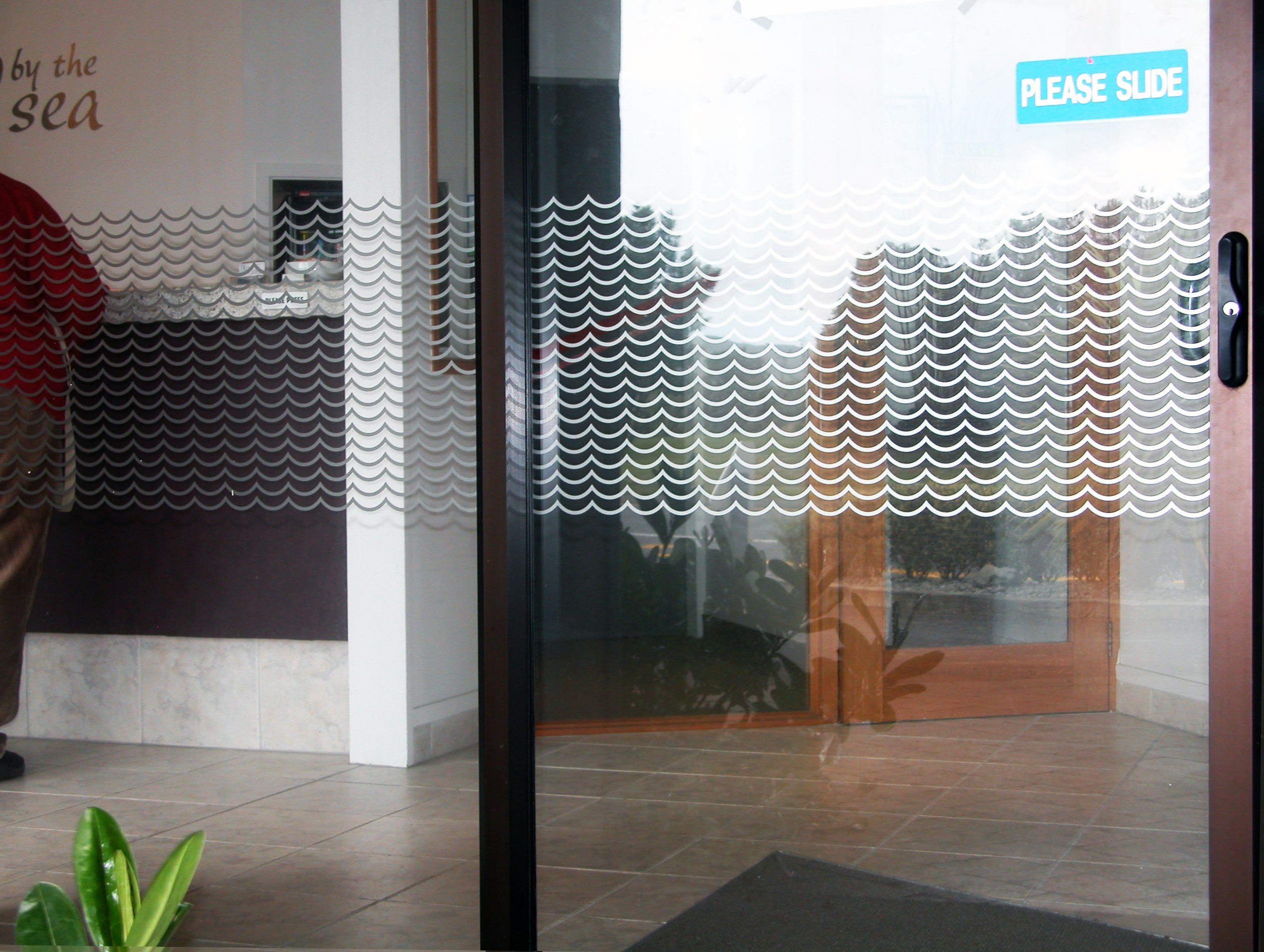 Window etch film with graphic design applied to windows