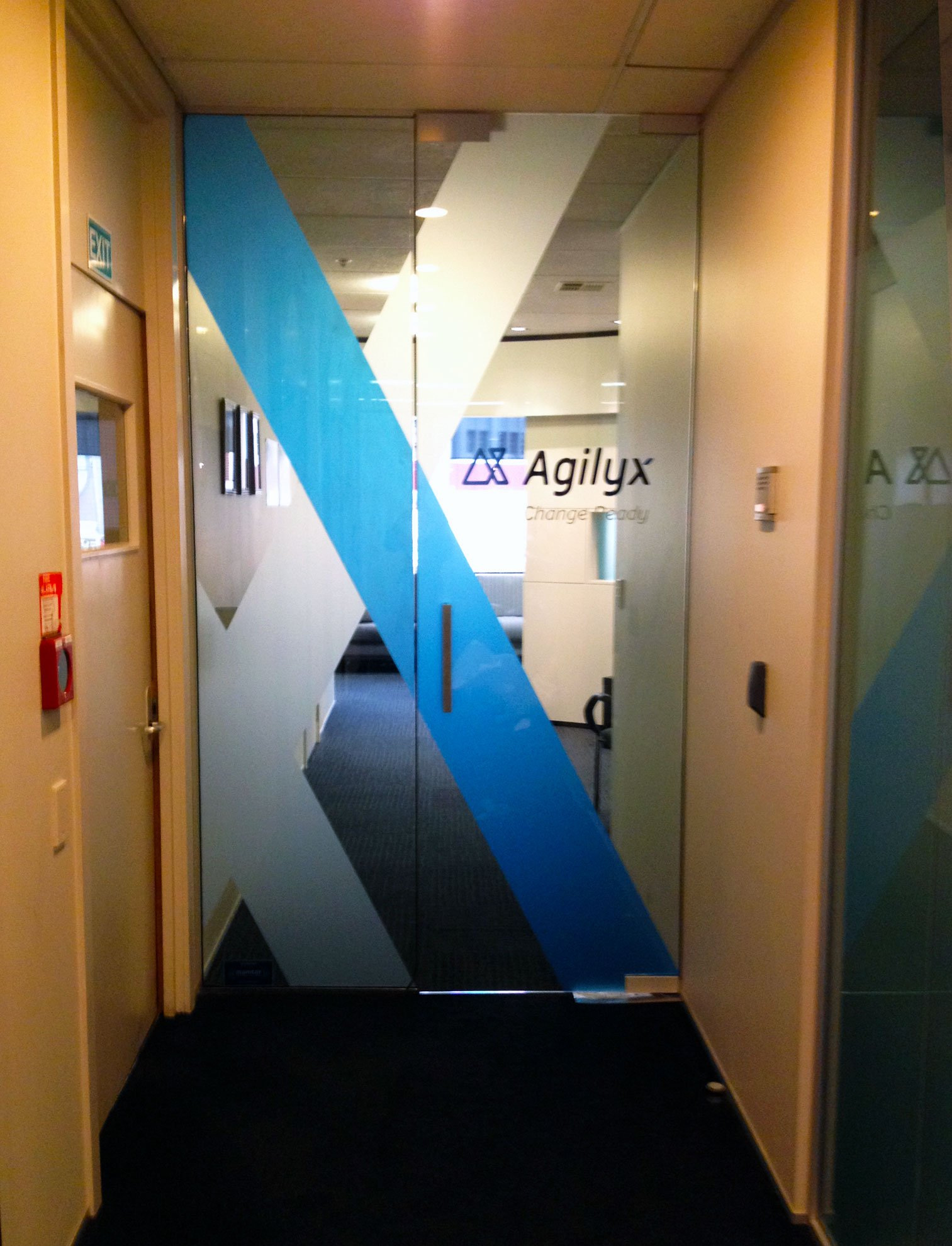 Window etch film and translucent vinyl applied to office entrance door