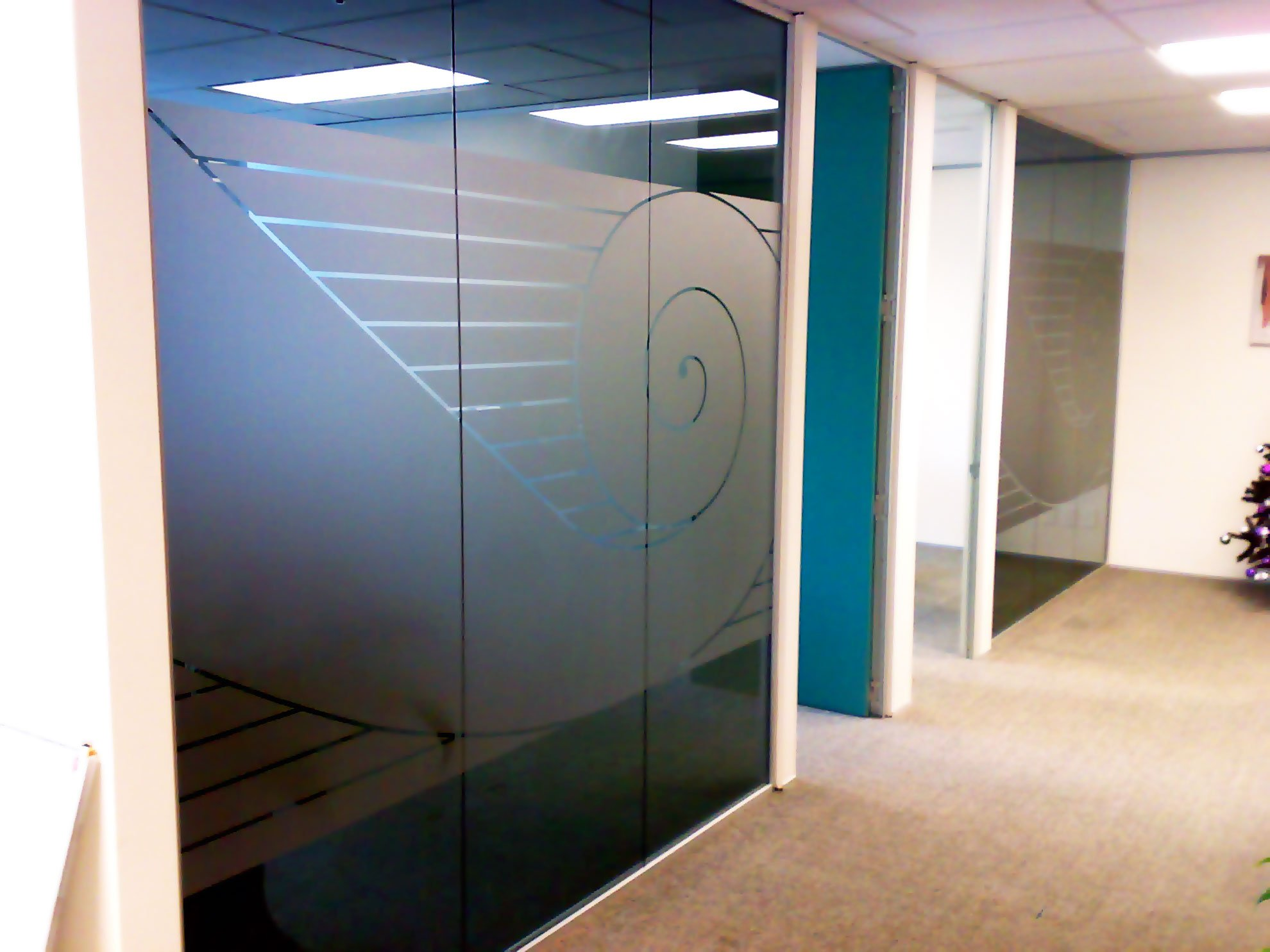Window etch film with graphic design applied to office windows