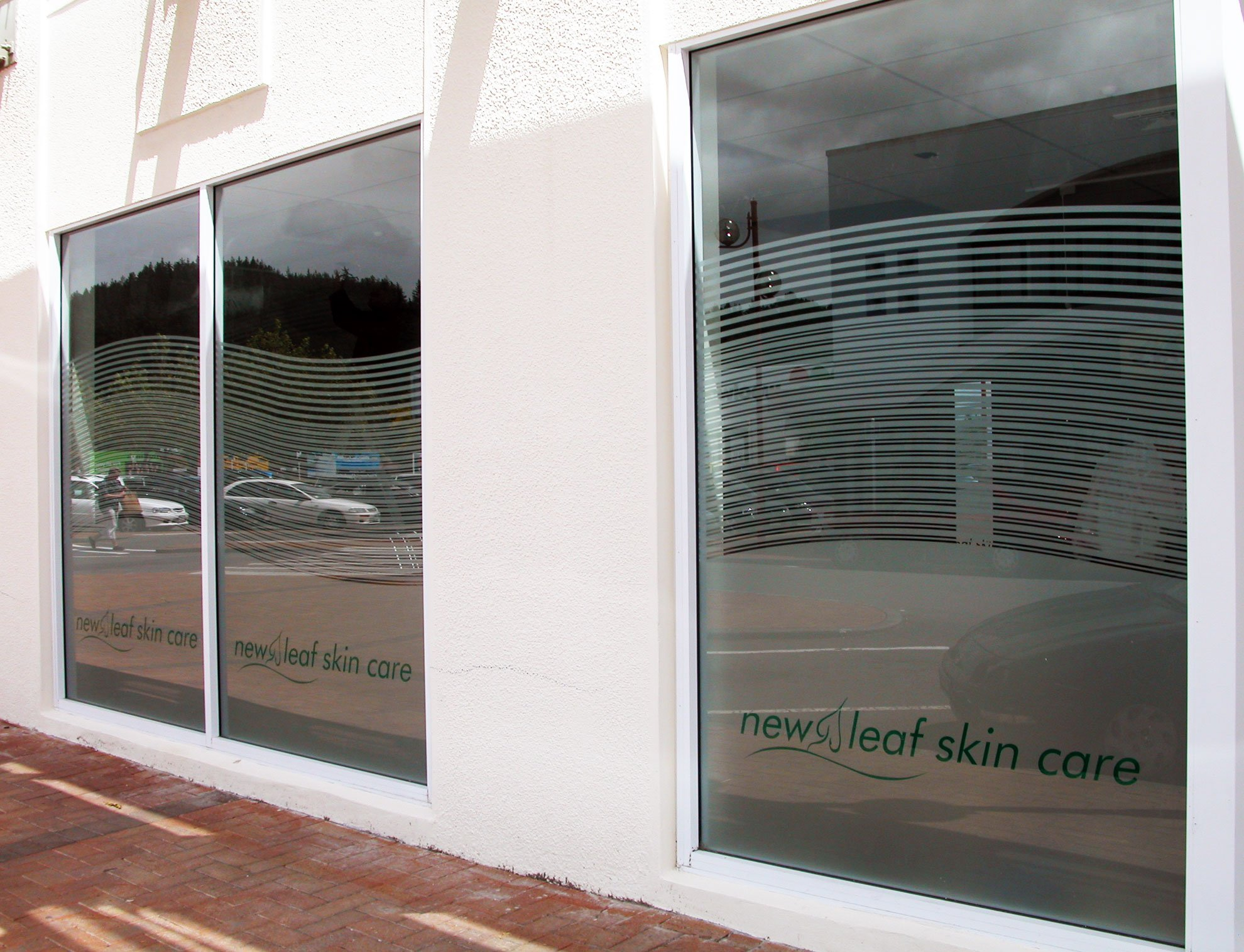 Window etch film and computer cut vinyls applied to windows