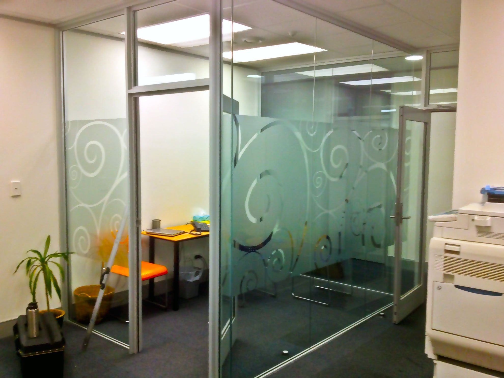 Window etch film with graphic design applied to office glazing