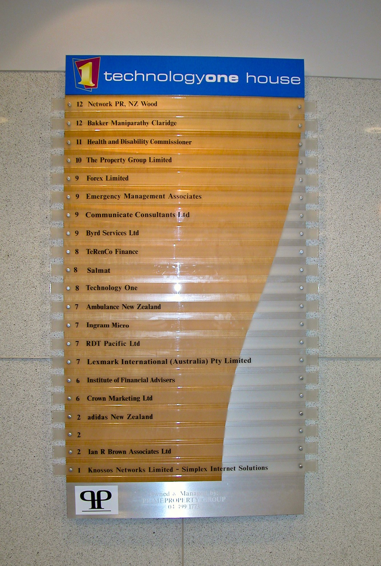 Computer cut vinyl lettering applied to clear acrylic directory panels