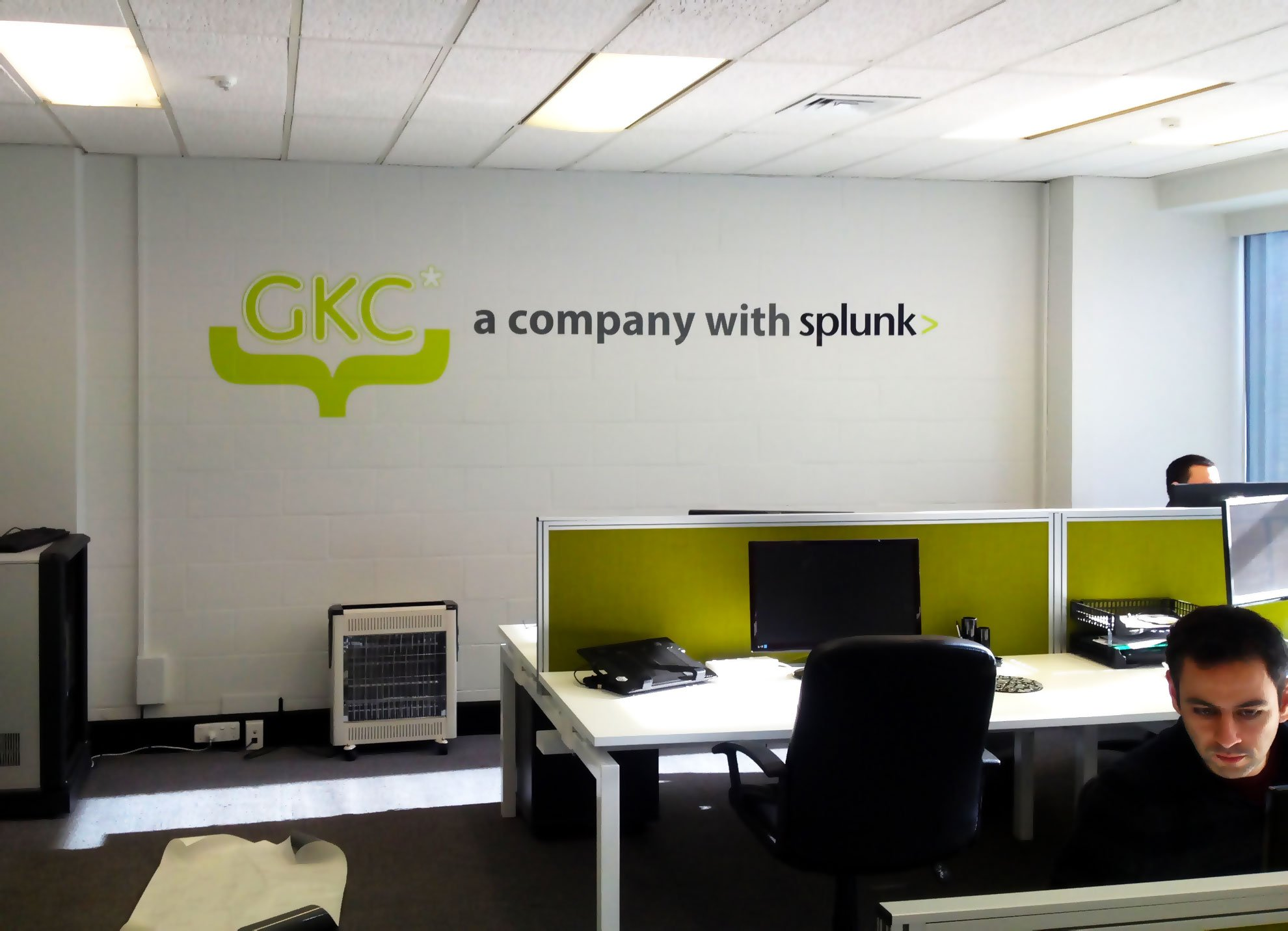 Computer cut vinyl lettering and logo applied to internal office wall