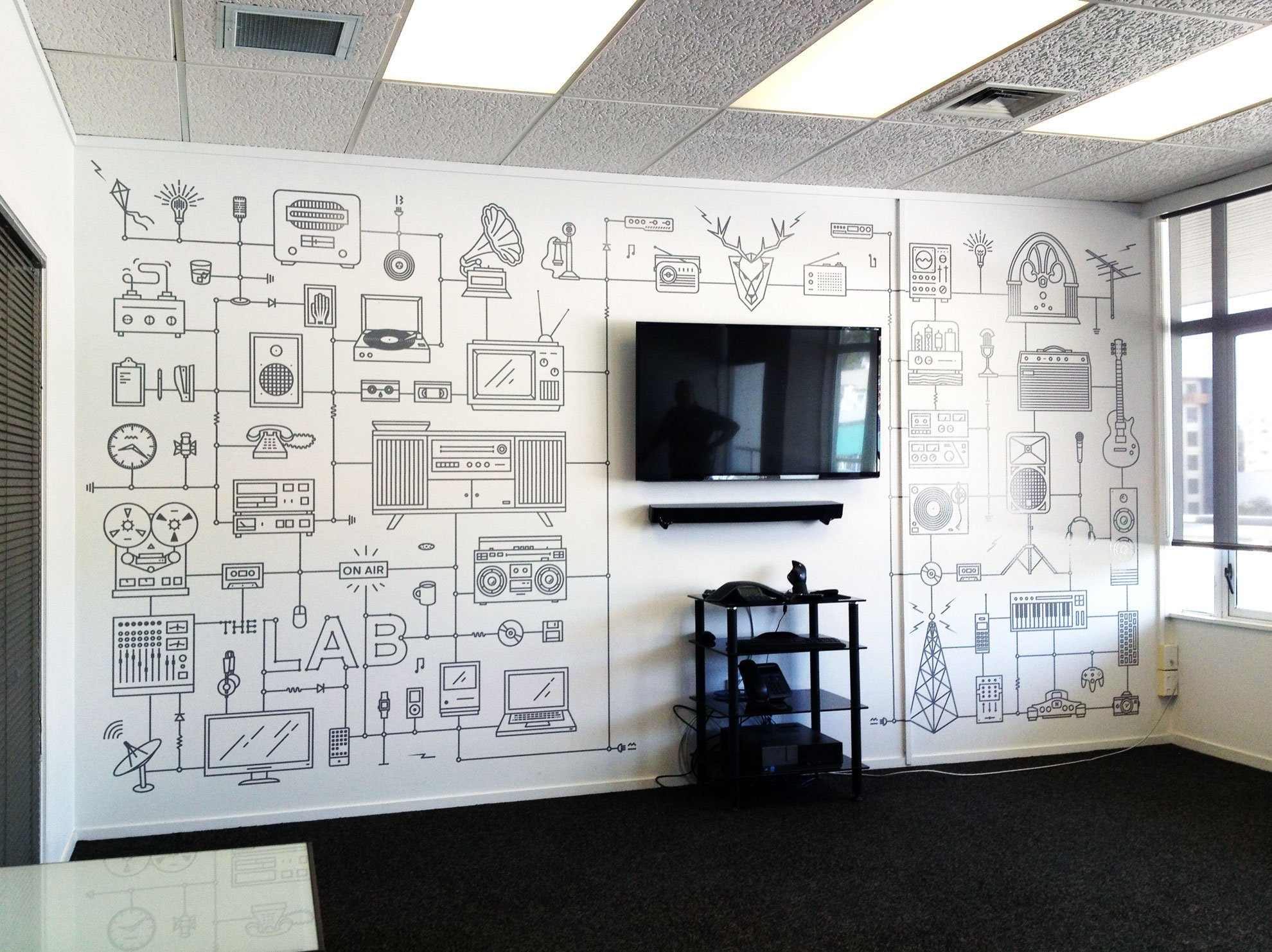 Computer cut vinyl graphics applied to meeting room wall
