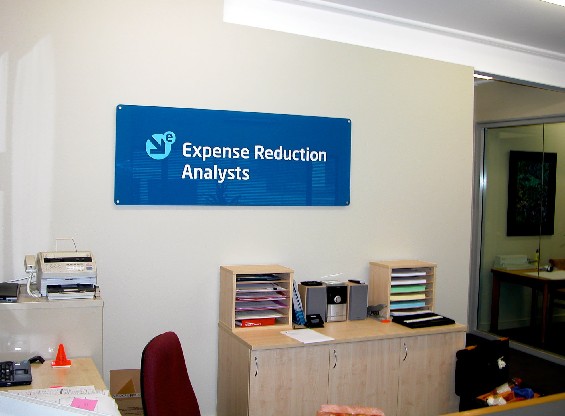 Perspex sign installed on office wall