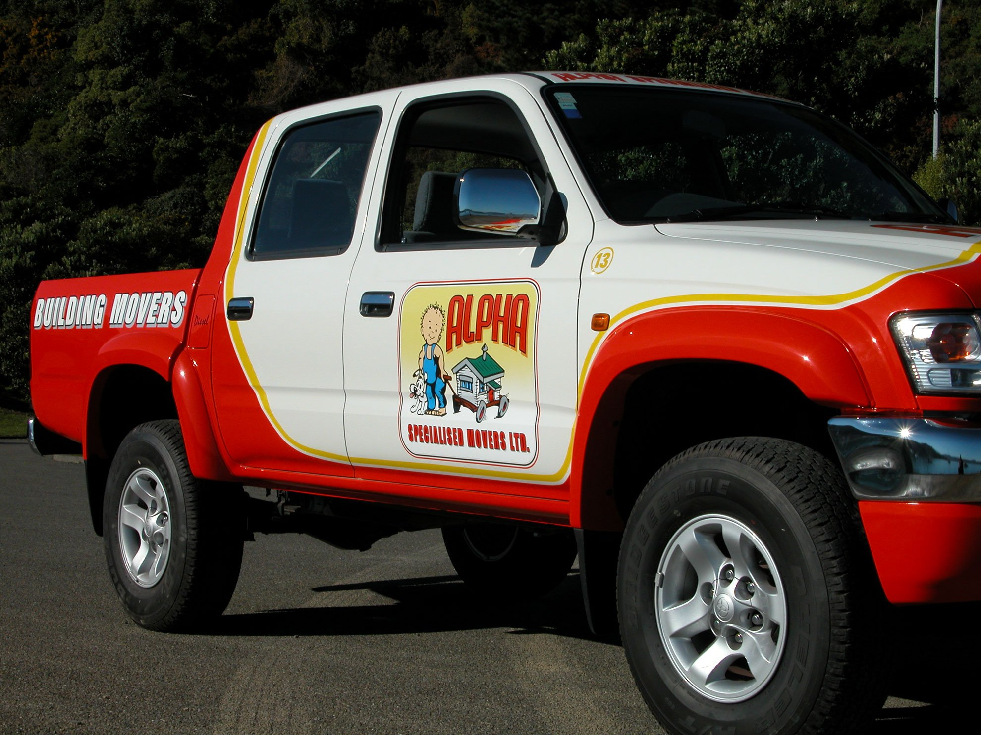 Hand painted logo and copy applied to ute
