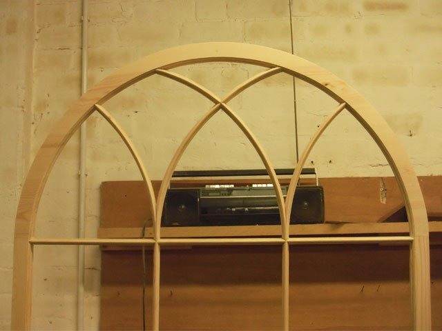 A stunning arched timber window frame constructed at B and P Joinery in Worcester