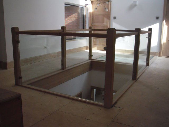 Timber landing rails on a mezzanine floor, constructed by B and P Joinery in Worcester