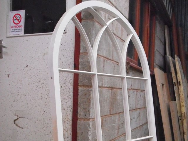 Painted and finished arched window frames created by B and P Joinery Services in Worcester