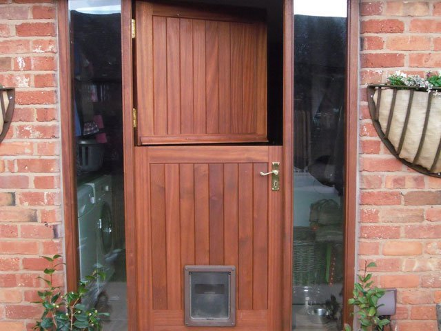 A timber stable door with cat flap, constructed by B and P Joinery in Worcester