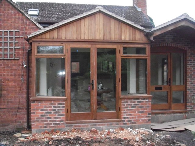 Bespoke timber French windows, installed by B and P Joinery from Worcester, in a newly built extension
