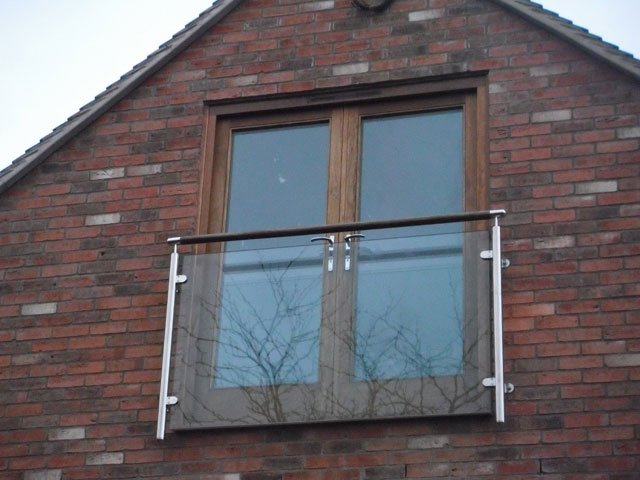 A Juliet balcony and timber French windows, installed by B and P Joinery in Worcester