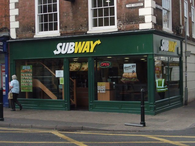A timber shop front and signage board, installed by B and P Joinery of Worcester