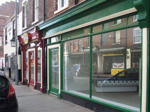A shop front with large window and door, constructed and installed by B and P Joinery of Worcester