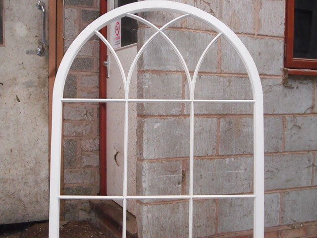 A stunning white, arched timber window frame constructed at B and P Joinery in Worcester
