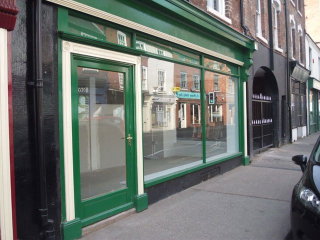 A green timber shop front installed by B and P Joinery of Worcester