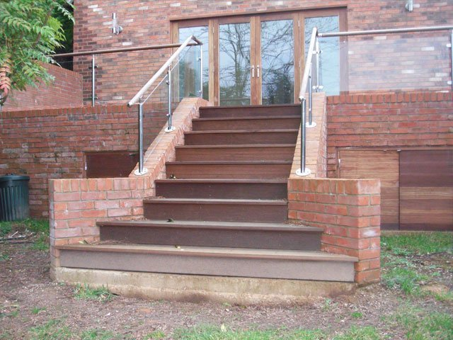A timber decking staircase installed in the garden of a new build house