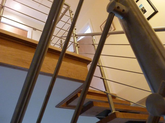 A timber floating staircase constructed and installed by B and P Joinery of Worcester