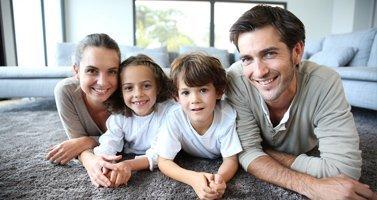 Family Posing on New Carpet Flooring, Clarence NY