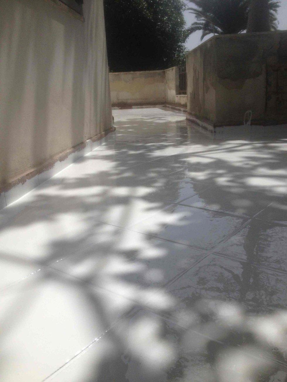Pavimentazione trattata con primer bianco