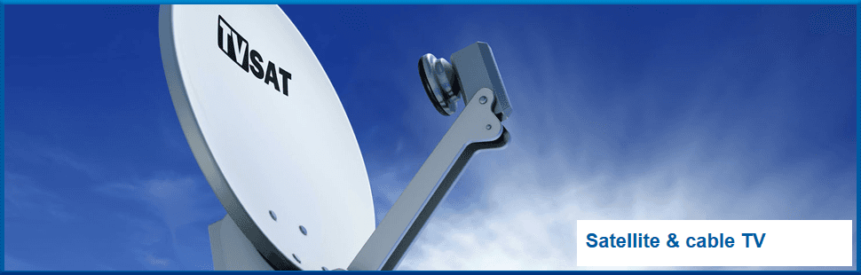Satellite dish with a blue sky and clouds