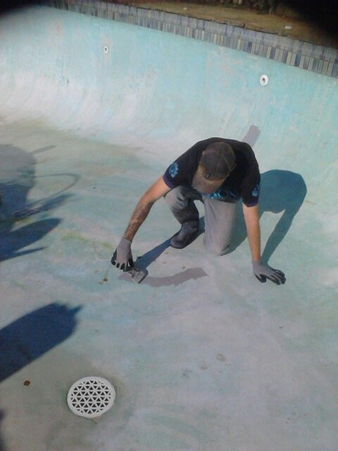 worker painting swimming pool in perth