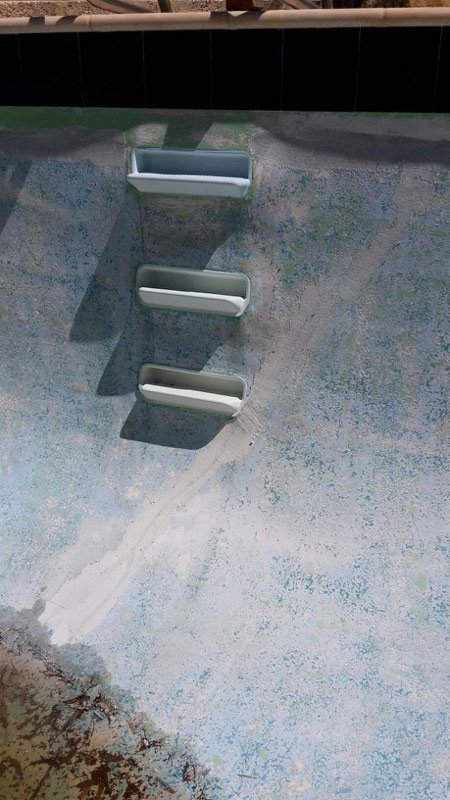 swimming pool stairs in need of paint