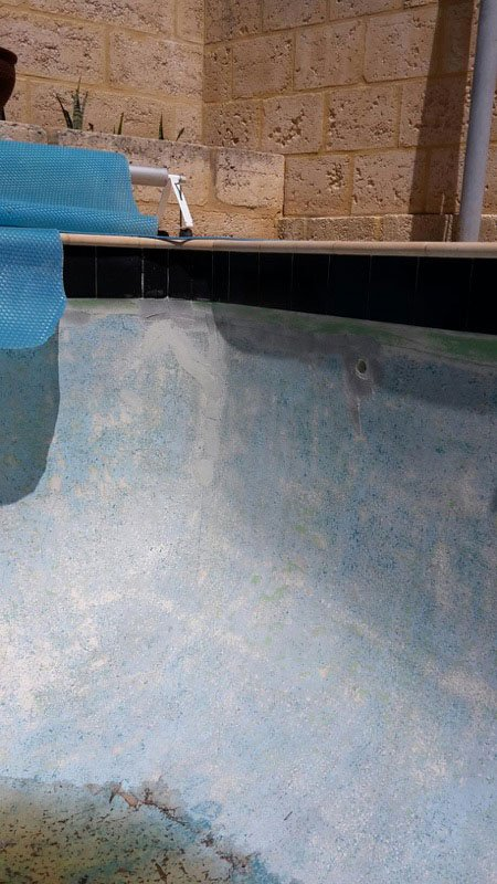 swimming pool wall in need of paint