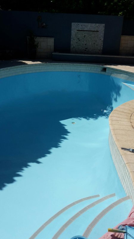 swimming pool in perth with new light blue paint