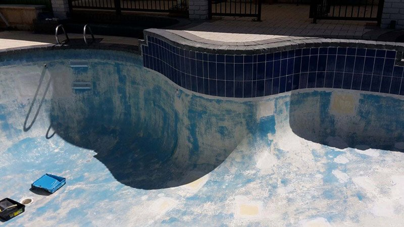 swimming pool with stripped paint