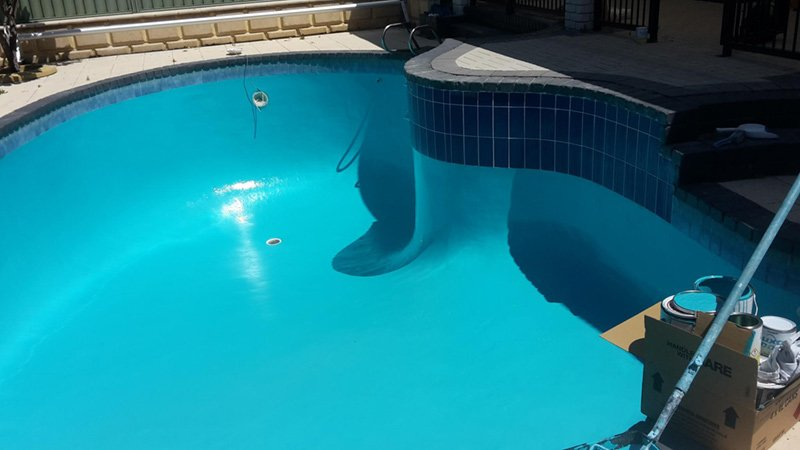 swimming pool with new teal paint