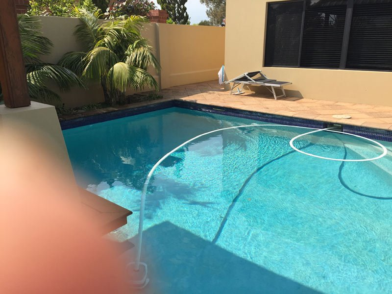 swimming pool being cleaned in perth