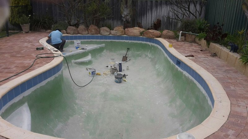 swimming pool getting new paint in perth