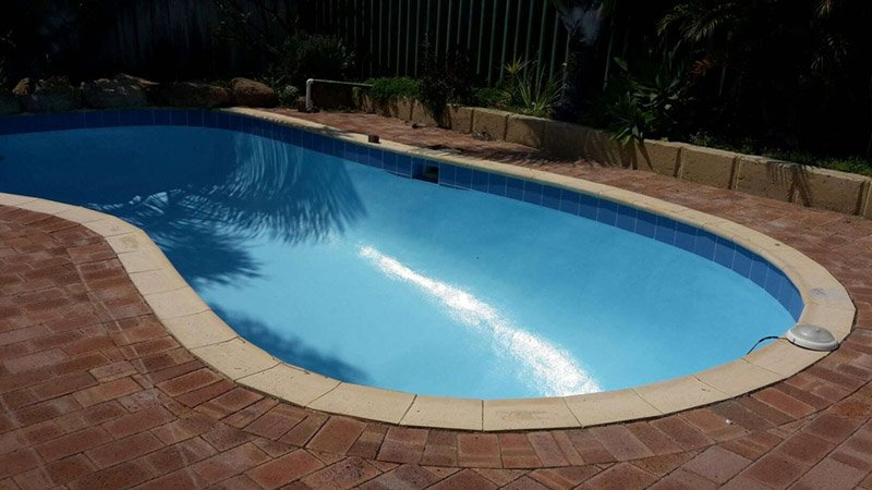 rounded swimming pool with new paint