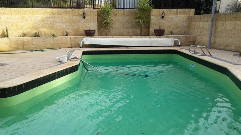 light green swimming pool with old paint