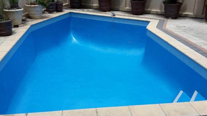 swimming pool with new bright blue paint