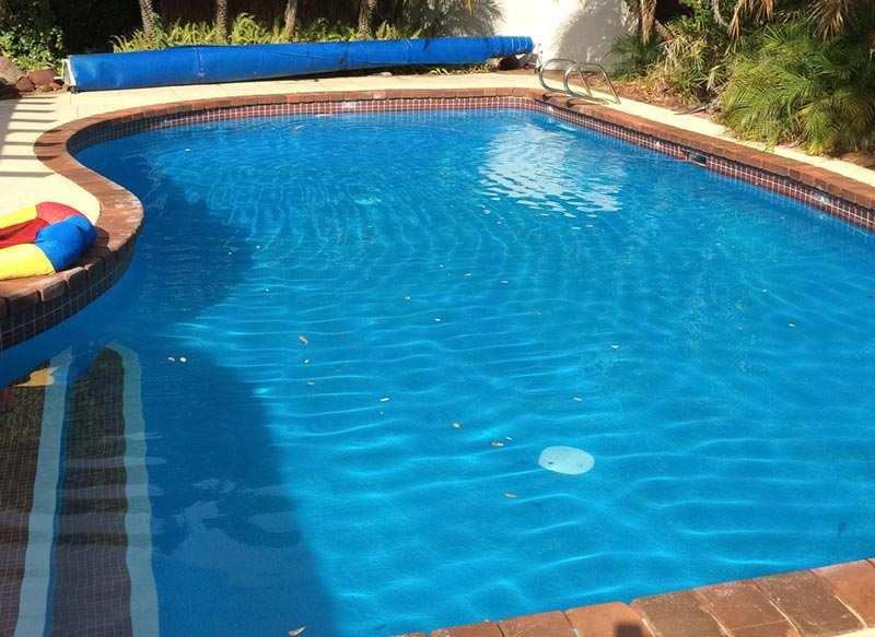 full swimming pool with new paint