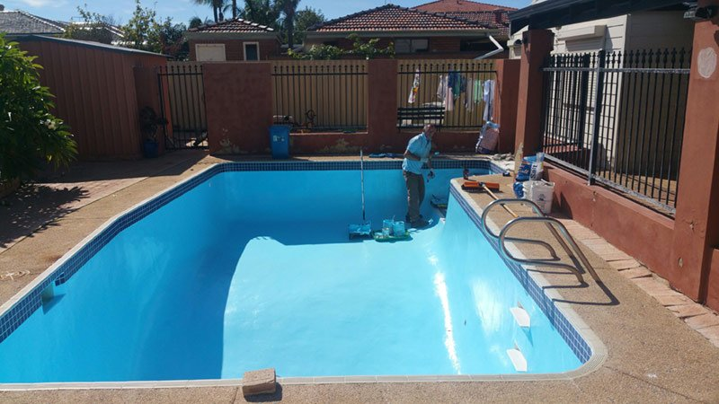 rectangle pool being painted with light blue